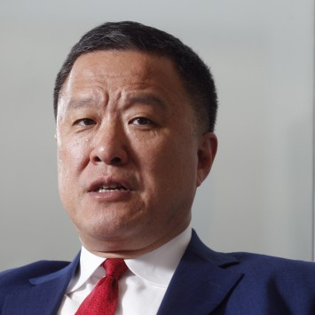 Cheung, chairman of RUSAL, speaks to reporters in Hong Kong