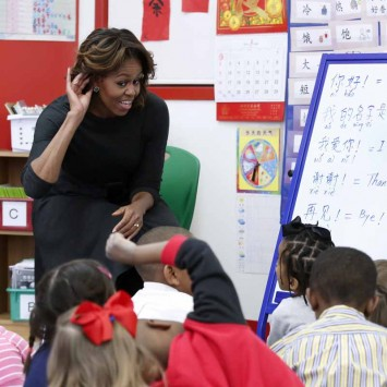U.S. first lady Michelle Obama participates in a language class with pre-school students at the Washington Yu Ying Public Charter School in Washington