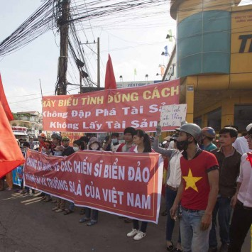 Workers hold banners during a protest in an industrial zone in Binh Duong province