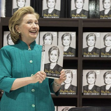 "Former U.S. Secretary of State Hillary Clinton smiles as she arrives to sign copies of her book ""Hard Choices"" at a Costco store in Arlington, Virginia"
