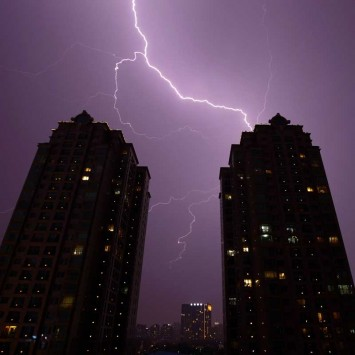 Lightning is seen above buildings in Beijing