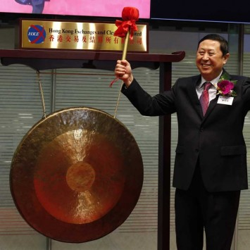Zheng Minghui, chairman of the board of the Qingdao Port Group, reacts after hitting the gong during the debut of Qingdao Port International Co. at the Hong Kong Stock Exchange