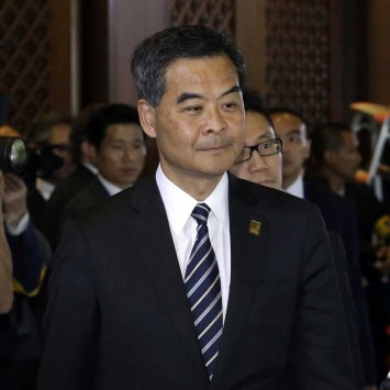 Hong Kong Chief Executive Leung Chun-ying arrives at the Leaders Retreat during the APEC Summit in Nusa Dua