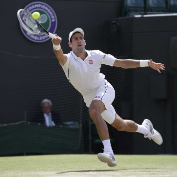 Novak Djokovic of Serbia hits a return during his men's singles quarter-final tennis match against Marin Cilic of Croatia at the Wimbledon Tennis Championships, in London