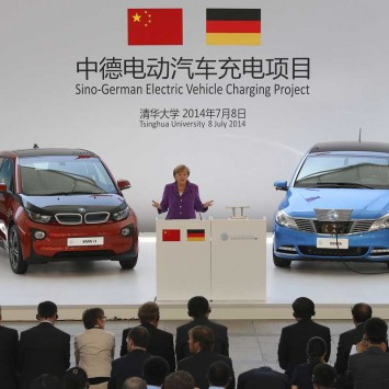 Germany's Chancellor Merkel delivers a speech at the opening ceremony of the Sino-German Electronic Vehicle Charging Project on the campus of Tsinghua University in Beijing