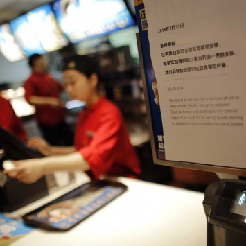 A sign at a McDonald's branch alerts costumers that there is only a limited menu available after a tainted food scandal involving Chinese supplier Husi Food Co Ltd, in Shanghai