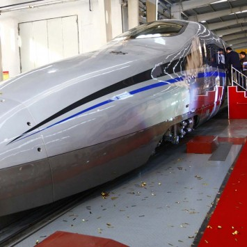 Visitors board a new testing model of a CSR high-speed bullet train during its launching ceremony in Qingdao