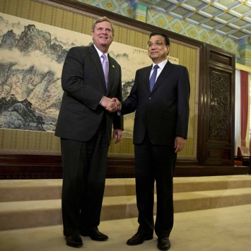 China's Premier Li shakes hands with U.S. Secretary of Agriculture Vilsack before their meeting in Beijing