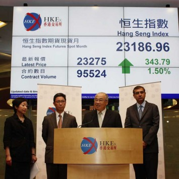 Hong Kong Exchanges & Clearing Ltd Chairman Chow makes a statement on establishment of Shanghai-Hong Kong stock market link, at the Hong Kong Stock Exchange