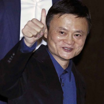 Alibaba Executive Chairman Jack Ma gives the thumbs-up after speaking to journalists ahead of an IPO roadshow, inside a hotel in Hong Kong