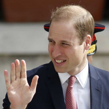 Britain's Prince William waves as he arrives for High Mass at St John's Co-Cathedral in Valletta