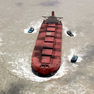Tugs move the damaged the Vale Beijing at Ponta da Madeira Port near the northern Brazilian city of Sao Luis
