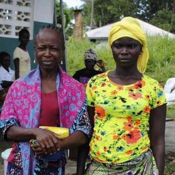 Survivors of Ebola virus pose for a picture outside a clinic near Tubmanburg