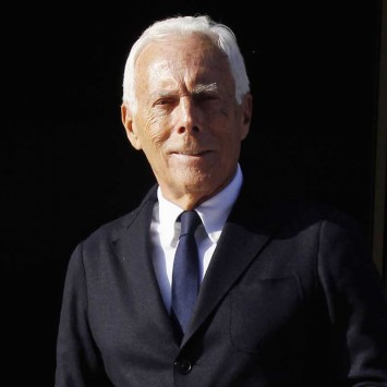 Italian designer Armani poses for photographers as he leaves the opening ceremony of the Armani Hotel Milano in Milan