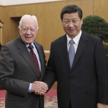 New leader of the Communist Party of China Xi Jinping shakes hands with former U.S. President Jimmy Carter during a meeting at Zhongnanhai, the central government compound in Beijing