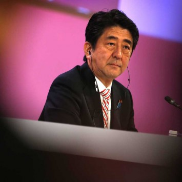 Japan's PM Abe waits to deliver opening keynote address at 13th IISS Asia Security Summit: The Shangri-La Dialogue, in Singapore