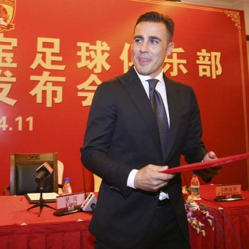 Former Italian soccer player Cannavaro holds the letter of appointment during a news conference announcing him as the new coach of Chinese Super League champion Guangzhou Evergrande Taobao Football Club, in Guangzhou