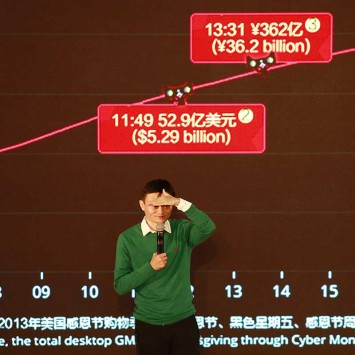 "Ma gestures as he speaks to media and staff in front of a giant electronic screen showing real-time sales figures of the company's Taobao.com and Tmall.com, on the ""Singles' Day"" online shopping festival, in Hangzhou"