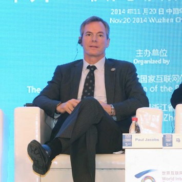 Qualcomm Chairman and CEO Jacobs sits next to Alibaba Group Executive Chairman Ma during a meeting at the World Internet Conference (WIC) in Wuzhen town