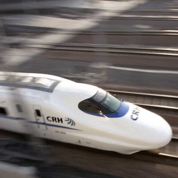 A bullet train speeds during its debut near a railway station in Shanghai