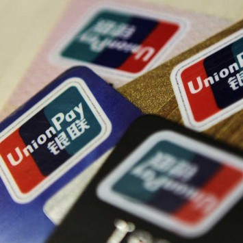 Logos of China UnionPay are seen on bank cards in this photo illustration taken in Beijing