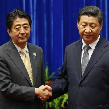 China's President Xi Jinping shakes hands with Japan's Prime Minister Shinzo Abe during their meeting on the sidelines of the APEC meetings in Beijing