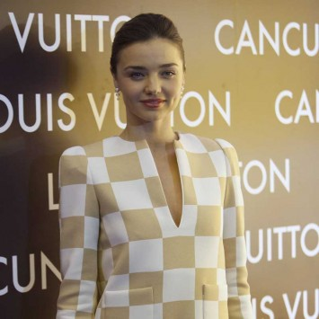 Model Miranda Kerr from Australia poses for a picture during the opening of a Louis Vuitton boutique in Cancun