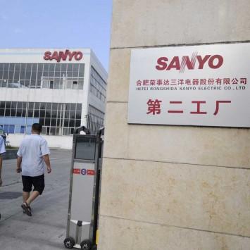Employees walk towards a factory of Hefei Rongshida Sanyo Electric in Hefei