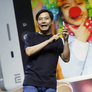 Lei Jun, founder and CEO of China's mobile company Xiaomi, demonstrates the new features of the new Xiaomi Phone 4 at its launching ceremony, in Beijing