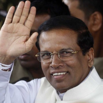 Sri Lanka's newly elected president Mithripala Sirisena waves at media as he leaves the election commission in Colombo