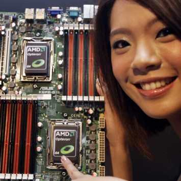 A model poses with AMD Opteron 6000 series processors on a motherboard during a product launch in Taipei