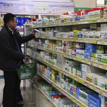 A customer shops at a pharmacy in Xuchang