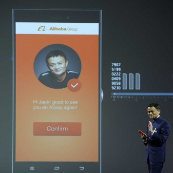 Alibaba founder and chairman Ma makes a presentation during the official opening of the CeBIT trade fair in Hanover