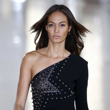 Model Joan Smalls presents a creation by designer Anthony Vaccarello as part of his Autumn/Winter 2015/2016 women's ready-to-wear collection during Paris Fashion Week