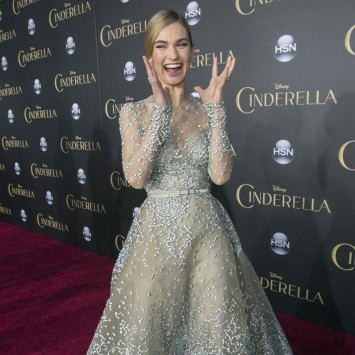 "Cast member Lily James laughs at the premiere of ""Cinderella"" at El Capitan theatre in Hollywood"