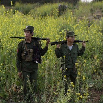 Rebel soldiers of Myanmar National Democratic Alliance Army (MNDAA) patrol near a military base in Kokang region