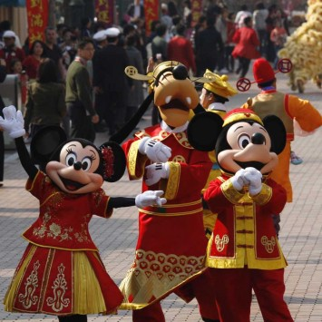 Characters at Hong Kong Disneyland greet visitors after a parade celebrating the upcoming Year of Ox