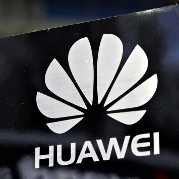 A Huawei logo is seen above the company's pavilion during the CommunicAsia trade show in Singapore