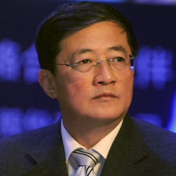 Ren Jianxin attends a meeting in Beijing