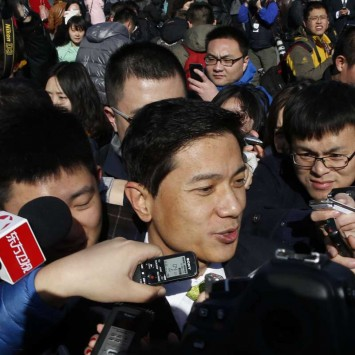 Baidu Inc. Chairman and Chief Executive Li is surrounded by the media as he arrives to attend the opening session of the CPPCC, at Tiananmen Square in Beijing