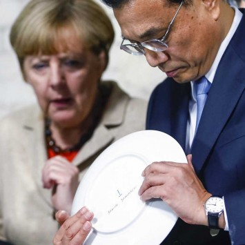 Germany's Chancellor Angela Merkel and China's Premier Minister Li Keqiang visit the Royal Porcelain Factory KPM in Berlin