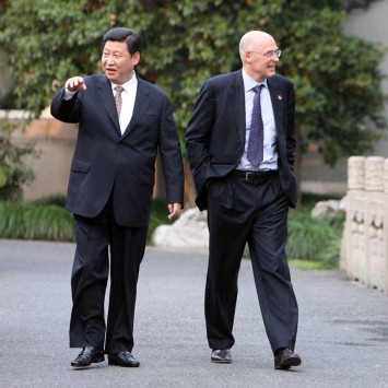 U.S Treasury Secretary Henry Paulson and Secretary of the Communist Party of China's Zhejiang Provincial Committee Xi Jinping take a walk in Hangzhou