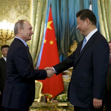 Russia's President Putin shakes hands with China's President Xi during their meeting at Kremlin in Moscow