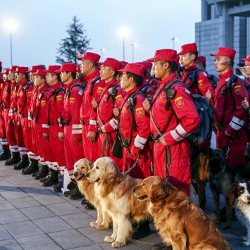 Members of Chinese International Search and Rescue Team and their rescue dogs gather before boarding a charted plane to Kathmandu, after a 7.9 magnitude earthquake hit Nepal, at Beijing Capital International Airport