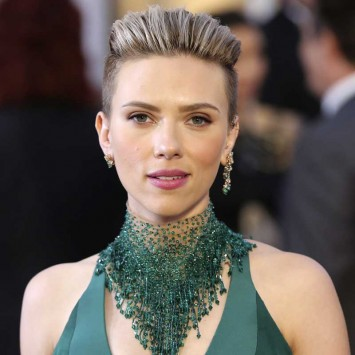 Actress Scarlett Johansson wears a Versace dress as she arrives at the 87th Academy Awards in Hollywood