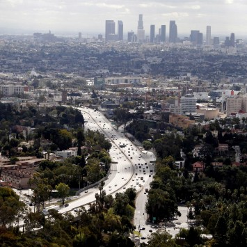 The skyline of downtown Los Angeles and the 101 Hollywood Freeway, a busy commuter route, is pictured from Mulholland Drive
