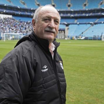 Brazil's former national soccer team coach Luiz Felipe Scolari walks on the field in Porto Alegre