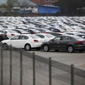 New cars are seen at a parking lot of Shanghai Volkswagen's car park in Shanghai