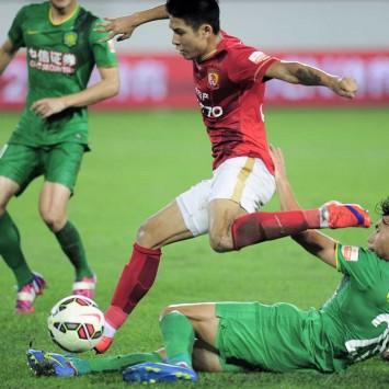 Guangzhou Evergrande Taobao play against Beijing Guoan during a soccer match, in Guangzhou, Guangdong province