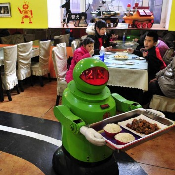 Robots deliver dishes to customers at a Robot Restaurant in Harbin